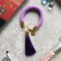 Сиренево-фиолетовый браслет с кисточкой